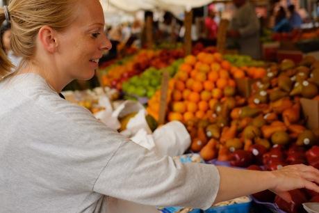Buying fresh fruit at Haymarket stalls